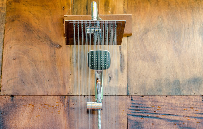 Water saving rain shower head spraying water